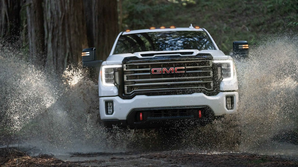 2021 GMC Sierra HD AT4 driving on low waters.