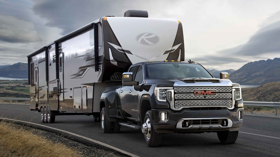 2021 GMC Sierra HD Denali towing and driving on the road.