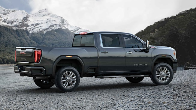Right-side view of the 2021 Sierra HD Denali parked outdoors.