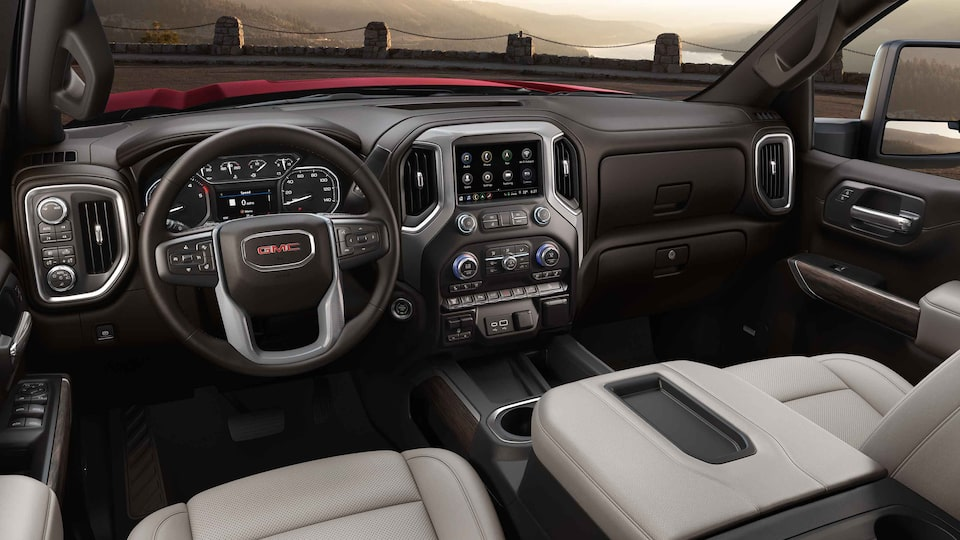 2021 Sierra HD SLE/SLT front interior featuring the dashboard, center console, and steering wheel.