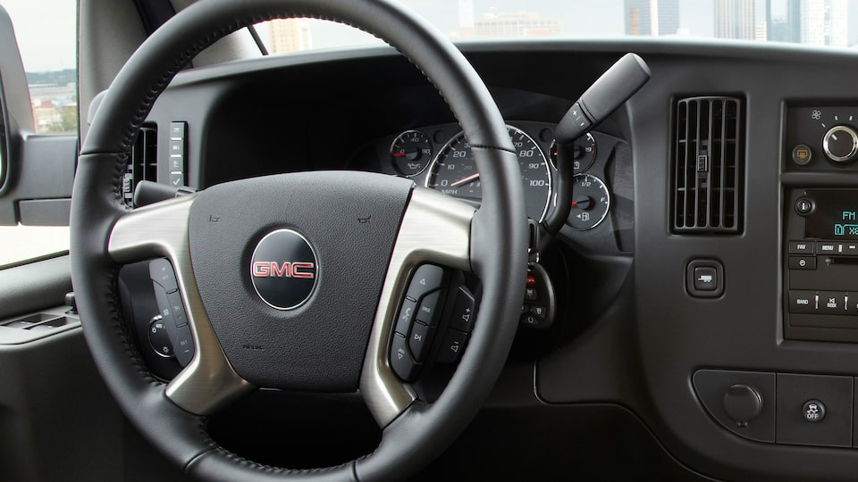 2019 GMC Savana Passenger Van's available leather-wrapped steering wheel.