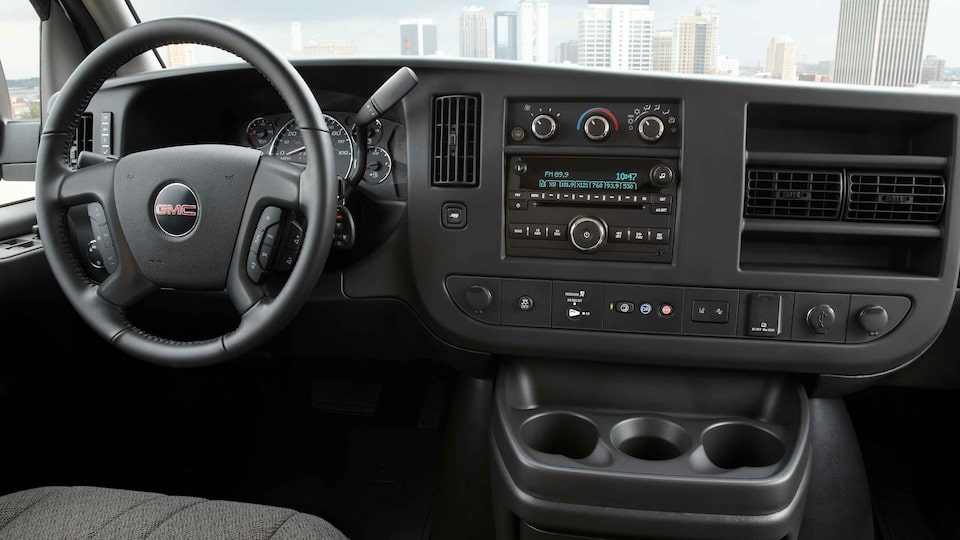 2021 GMC Savana Cargo dashboard featuring the steering wheel and controls.