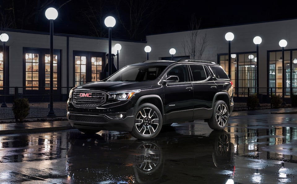 Exterior front profile of a black 2019 GMC Acadia All-Terrain edition.