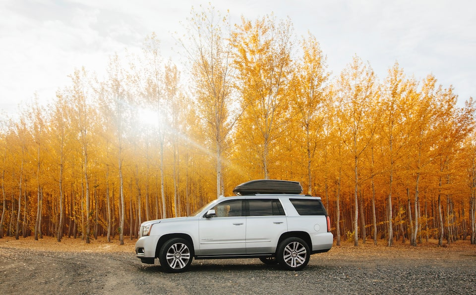 2020 GMC Yukon Denali Ultimate Full Size SUV Side View With Top Carrier.