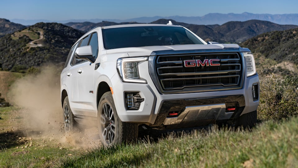 2021 GMC Yukon AT4 driving off-road.
