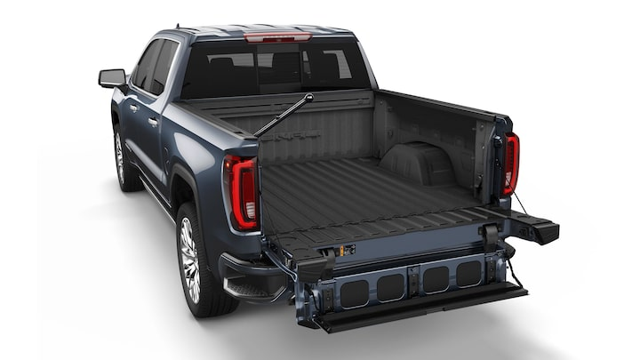 2019 GMC Sierra 1500 with a fully opened tailgate with stepping platform.