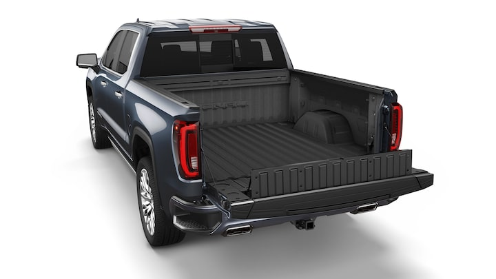 Sierra 1500 with an opened tailgate featuring the load stopper.