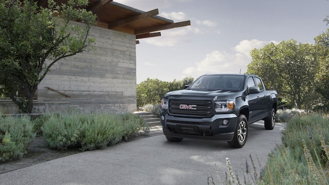 2020 Canyon All Terrain Mid-Size Truck Road Less Traveled Next To House.