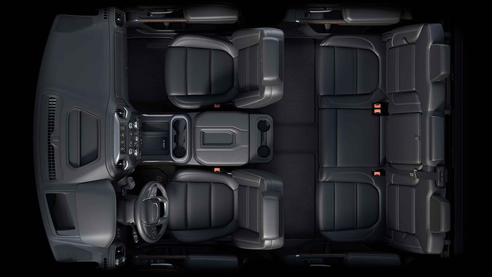 Bird's-eye view of the 2021 Sierra HD interior jet black front seating.